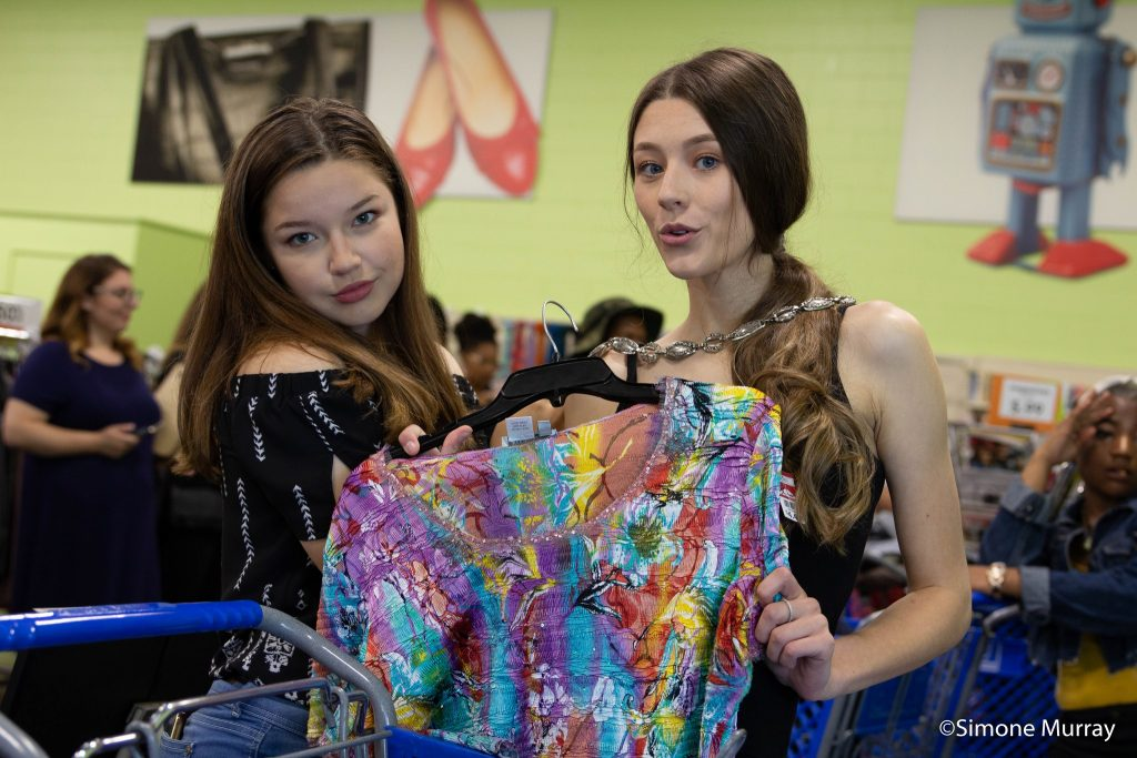 Two young women posing with a rainbow colored blouse for Imagine IFF Youth fashion Camp