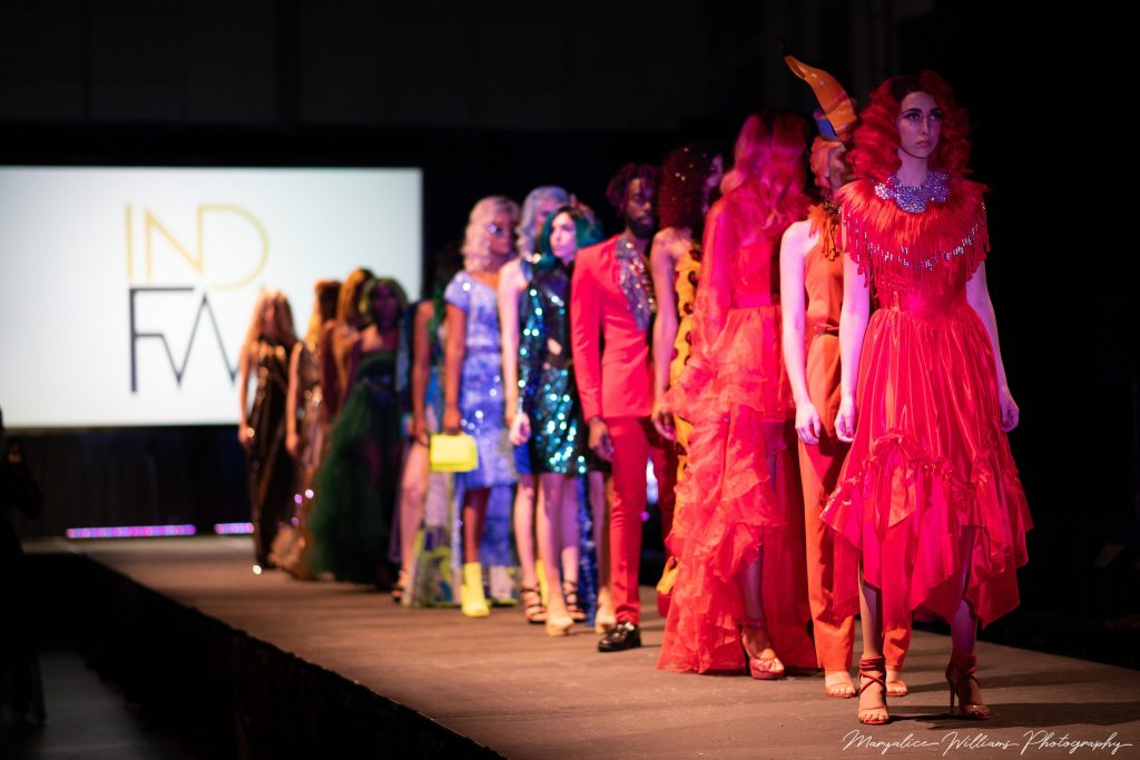 Fashion models on a runway in a color wheel-inspired palette